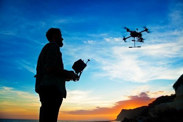 person flying drone