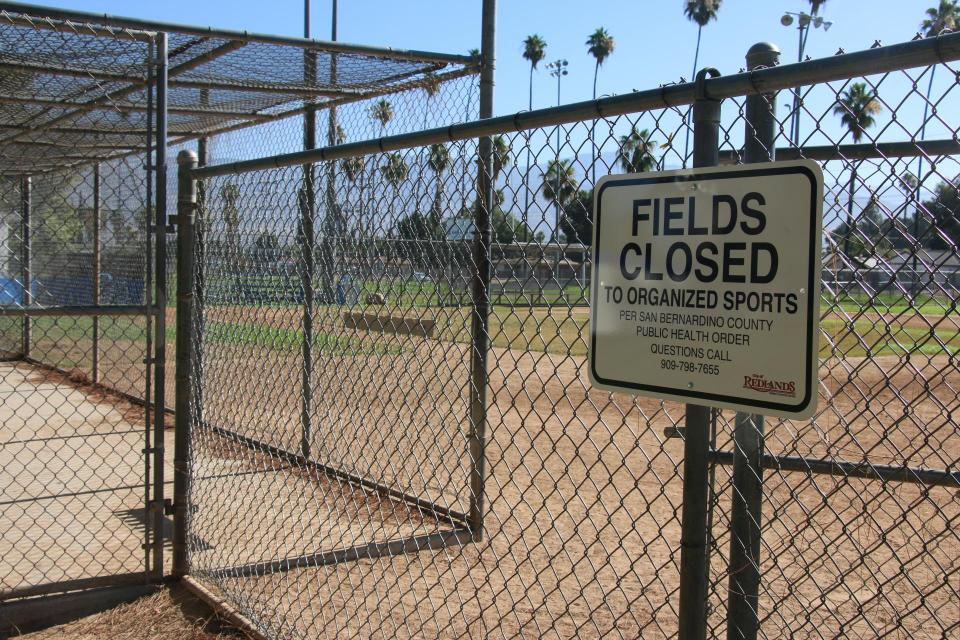 A sign at one of Community Field's baseball fields announces that the field is closed to organized sports.