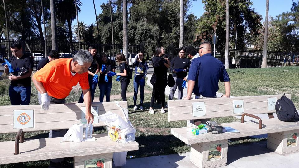 Volunteers clean park area and benches
